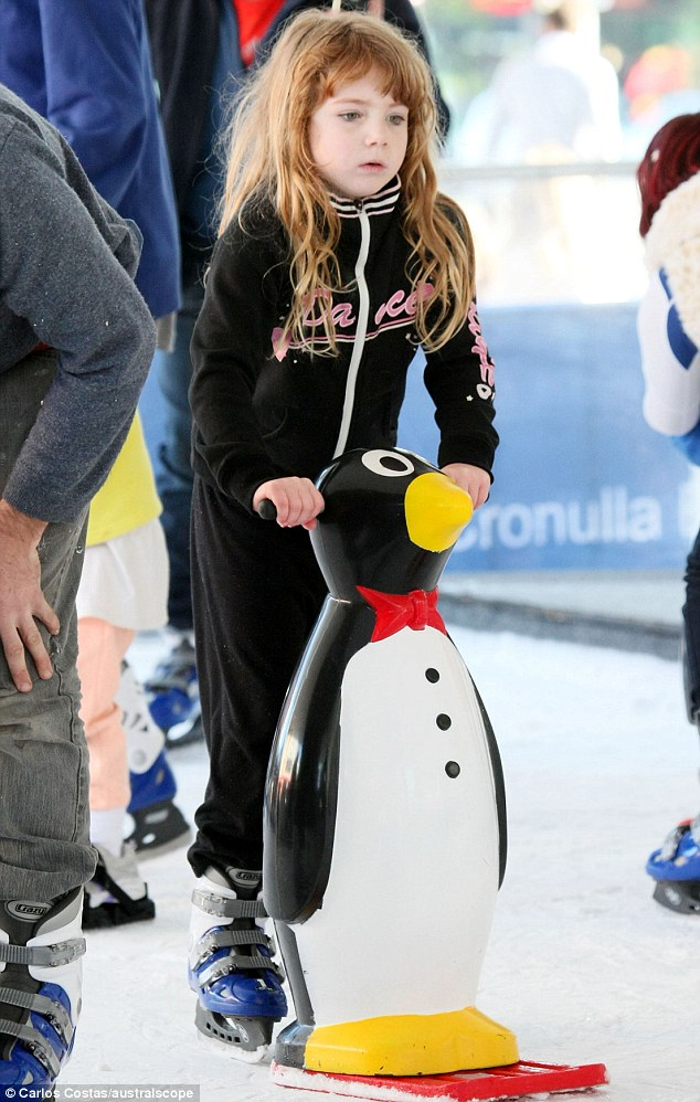 Me and my penguin: Susie's eldest daughter Paris, five, looked like a natural on the ice. The marathon swimmer first hit the waters aged four before winning her first gold aged 14