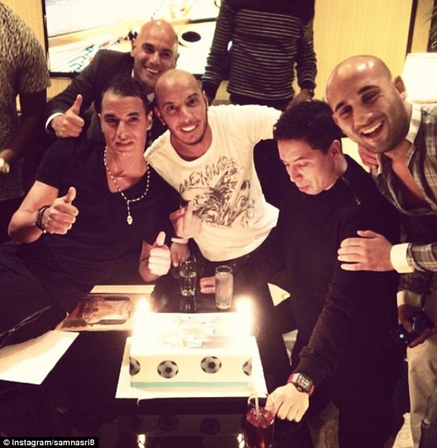 Cake: Nasri (second right), Chamakh (left) and friends celebrate on a night out