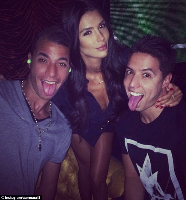 Playful: Nasri posted pictures on holiday with his girlfriend (centre) and Marouane Chamakh