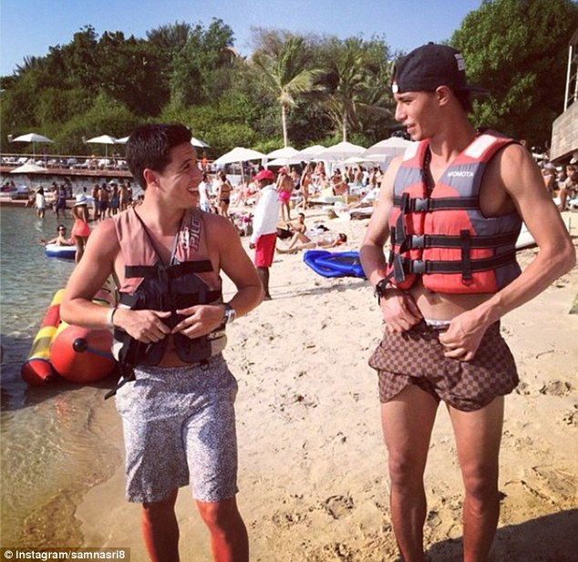 Fun in the sun: Nasri (left) and Chamakh put on life jackets on the beach