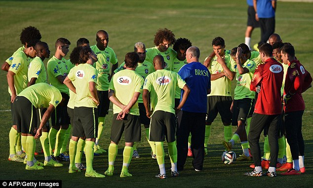 Team talk: Scolari talks to his players during training on Thursday ahead of the clash with Colombia