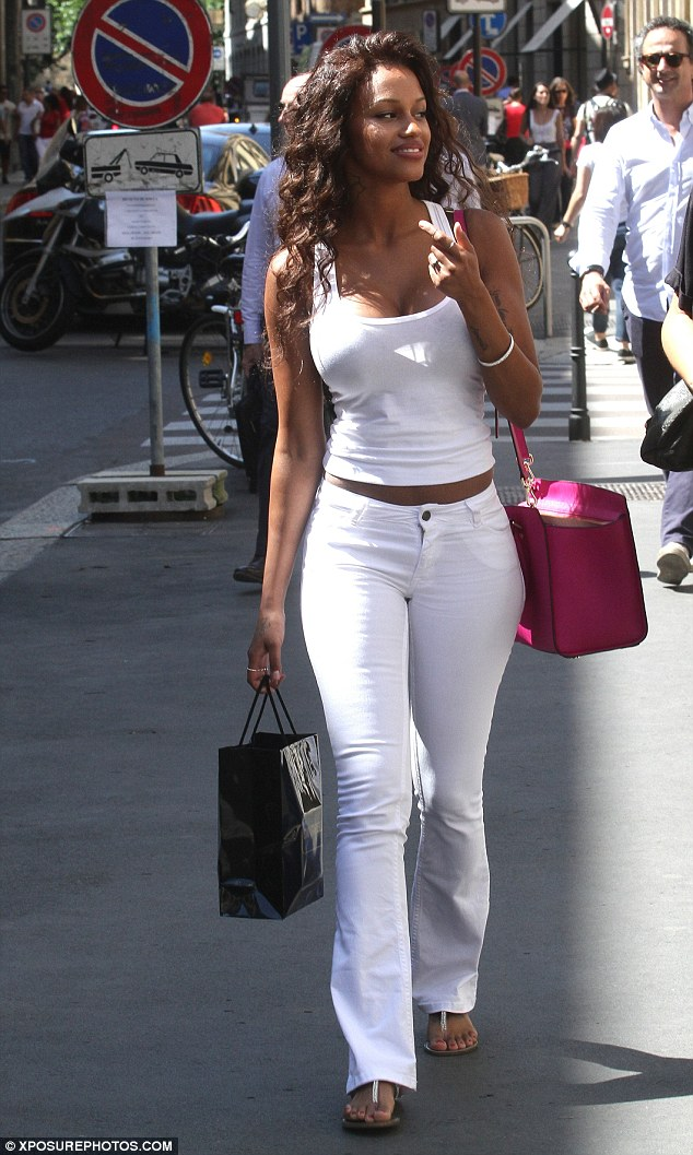 All white: Fanny went for a summery look as she hit the shops in Milan, picking up several items as she strolled around the city