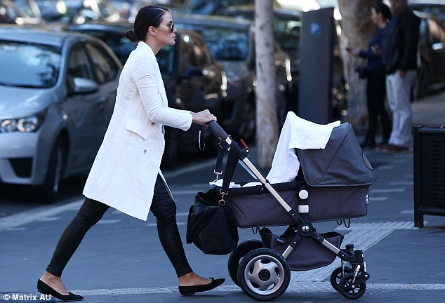 Strides: She loves to keep fit and the star even looked agile when pushing the pram