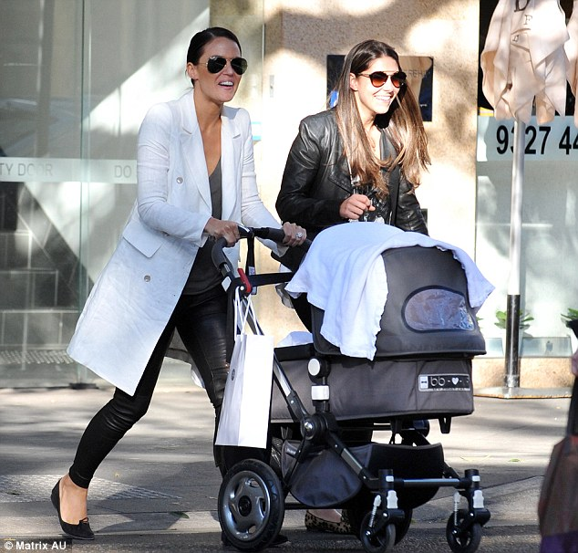 Girlie day out: The pair looked like they were having a great catch up as they walked with Aleeia in the buggy
