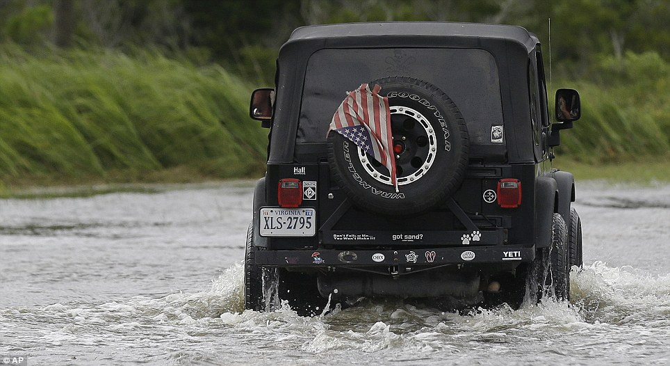 Land of the free: The Fourth of July was spent doing clean-up and salvage in the Outer Banks as flood waters slowly receded