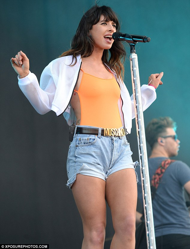 Foxy lady! Foxes looked great in denim hotpants and a skimpy bright orange top as she performed on stage