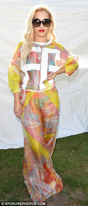 A tale of two outfits: Rita arrived at the London-based music event in an abstract multi-coloured semi-sheer Fyodor Golan gown with white motif detailing