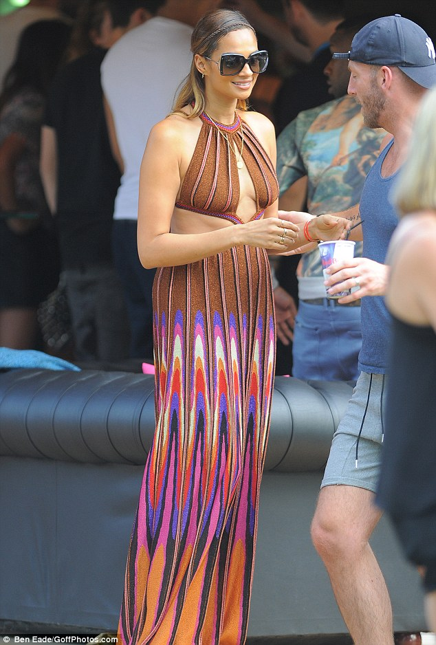 Fun in the sun: Alesha Dixon looked incredible in a multi-coloured halterneck dress with cut-out panels at the side