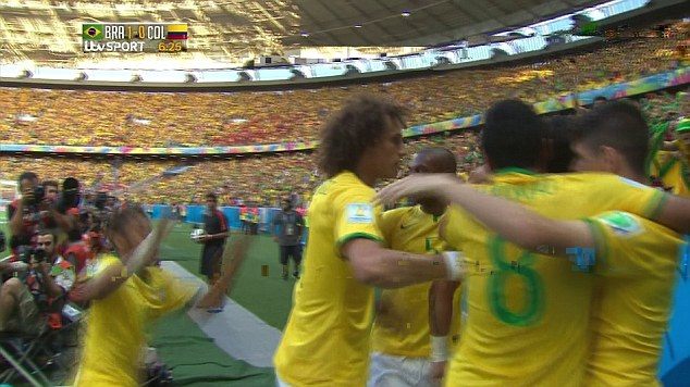 Disappearing act: Neymar (left) slips as he goes to join his team-mates in celebrating the opening goal