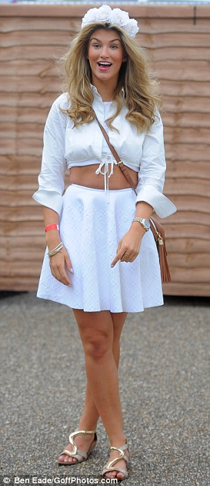 Festi-chic: The model rocked a cute tie-up shirt and a flirty skater skirt for the occasion