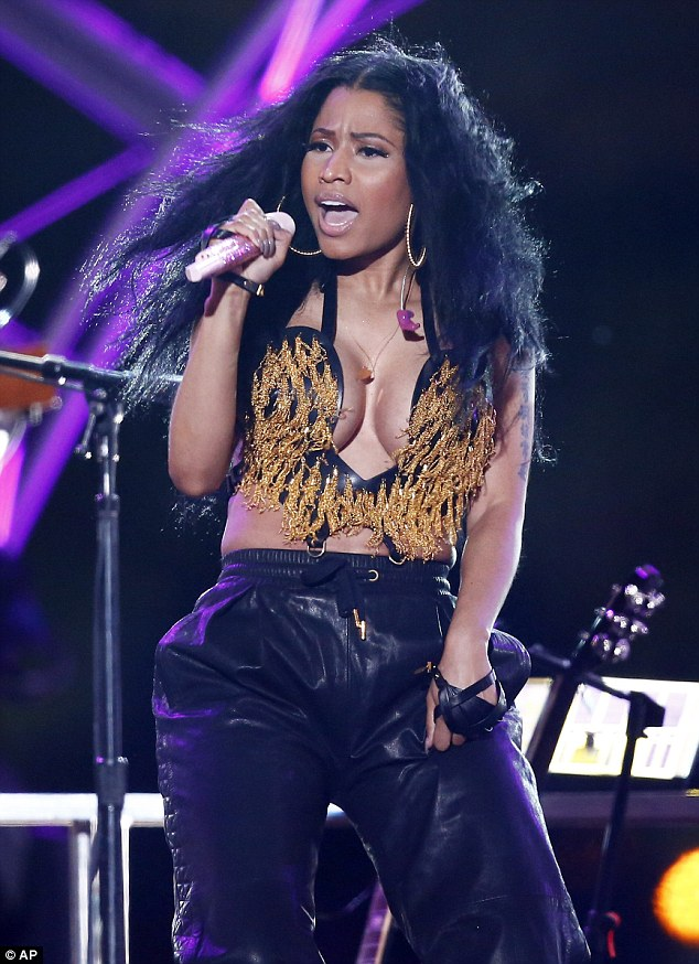 Taking the plunge: Nicki Minaj wore a revealing ensemble as she performed at a 4th of July celebration in Philadelphia on Friday