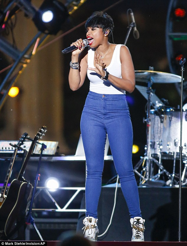 Summer style: The actress and performer wore high waisted jeans and high tops for the concert