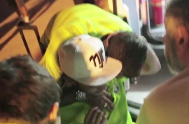 Get well soon: Thiago Silva hugs Neymar as the Brazil team wish their star man well after his injury