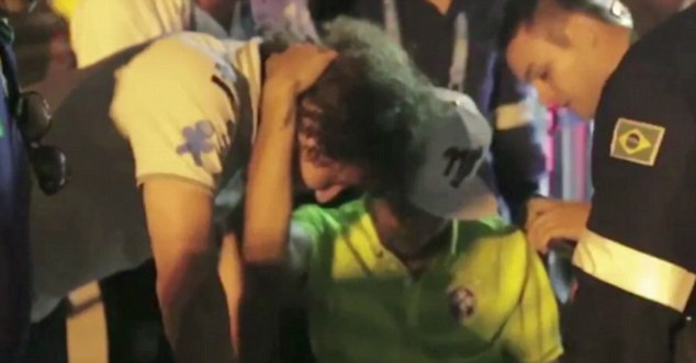 Emotional: David Luiz hugs Neymar as he waits to board an ambulance after Friday's win over Colombia