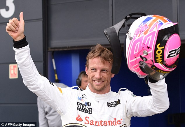 Fitting: Button celebrates claiming a place in the top three as he wore a helmet in tribute to his late father