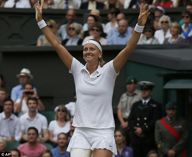 The moment: Kvitova drops her racket after hitting a superb winner on championship point at SW19