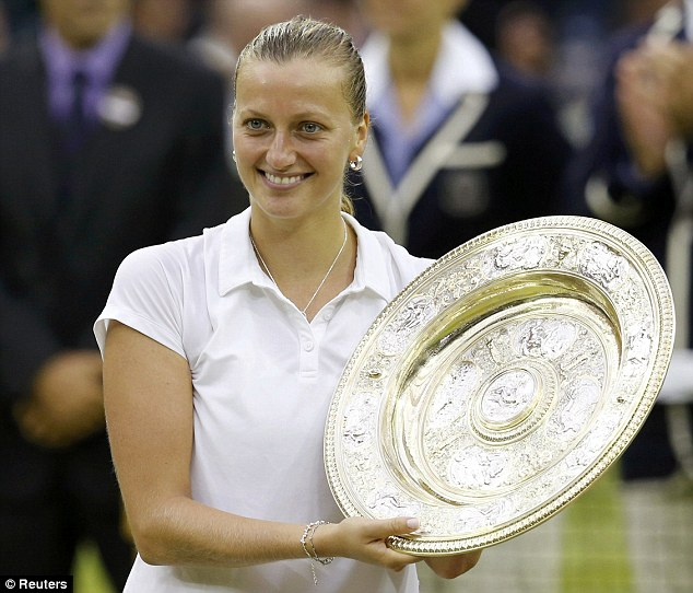 Victorious: Petra Kvitova is the 2014 women's Wimbledon champion after beating Eugenie Bouchard 6-3, 6-0