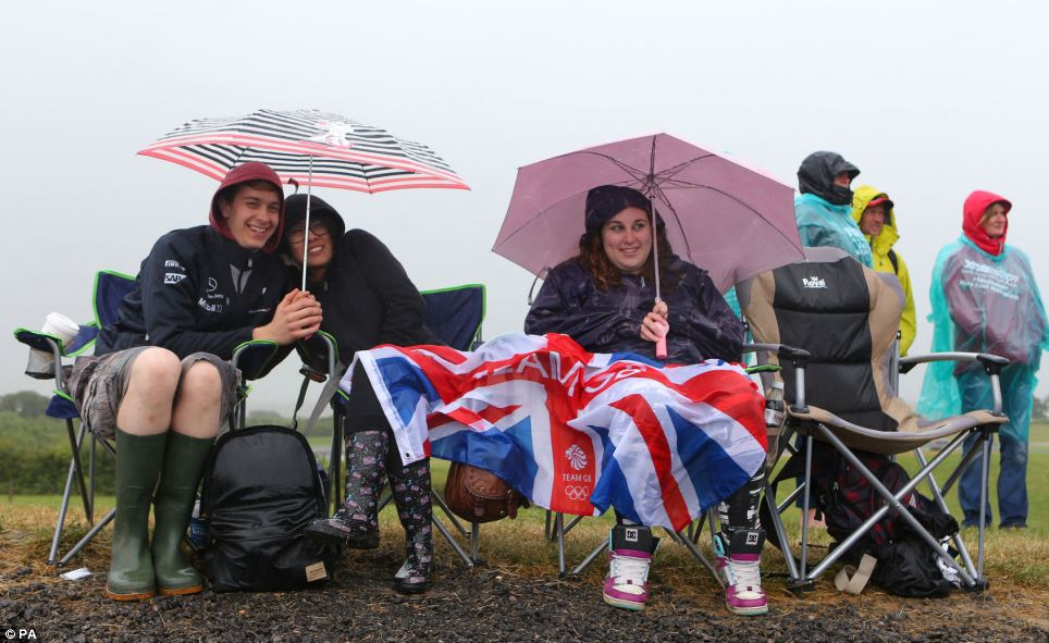 Sports fans: Donning rain ponchos and wellies, tens of thousands of Formula One fans watched the qualifying stages of the British Grand Prix unfold at Silverstone today