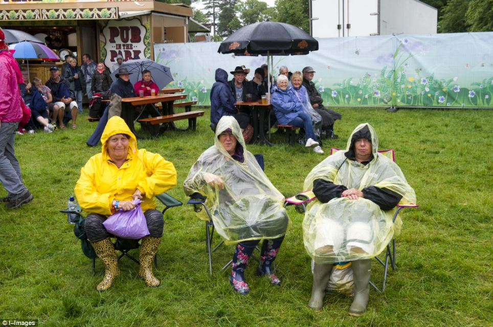 Festival: The wet weather is not set to improve anytime soon - with further downpours expected tomorrow and throughout next week. Above, Cornbury Music Festival
