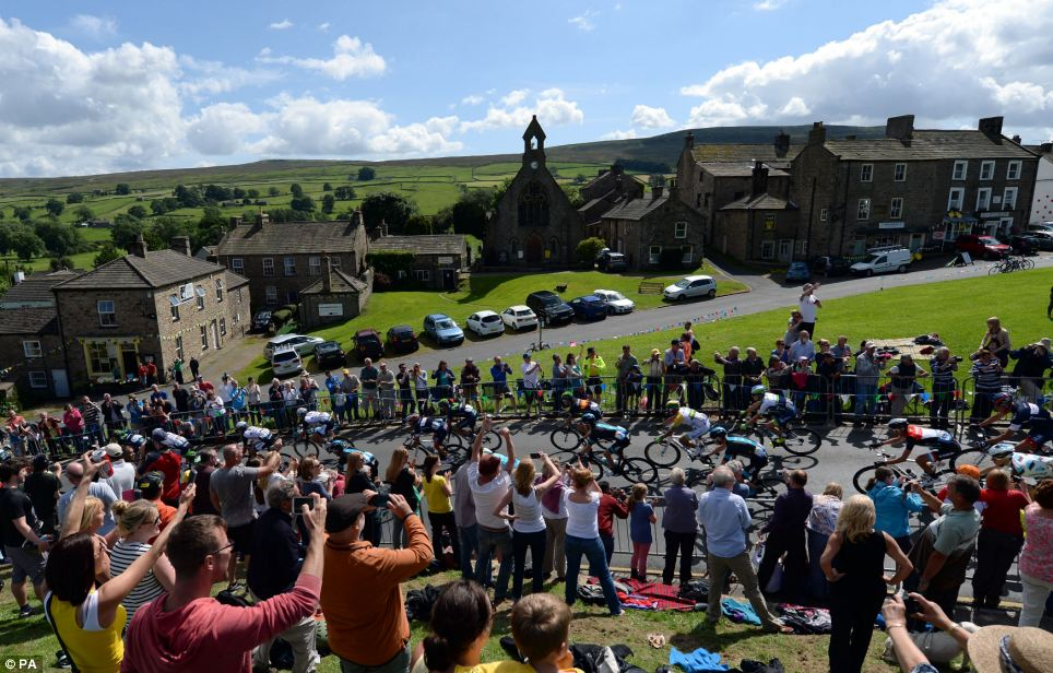 Better weather: But cycling enthusiasts in Yorkshire were treated to sunshine and dry weather as the opening stage of the Tour de France got underway in Leeds