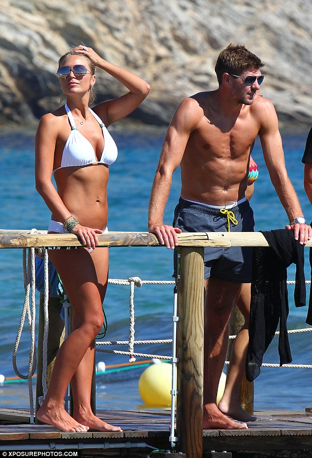 The beautiful beach people: Alex and Steven Gerrard bask in the sun at Blue Marlin club in Ibiza on Friday