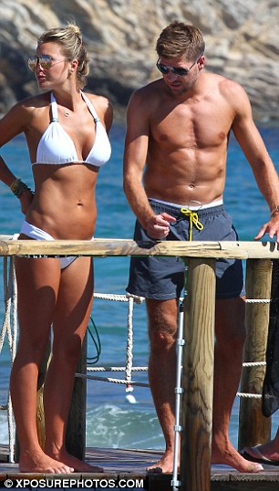 His and her abs: The pair both flaunted their toned stomachs