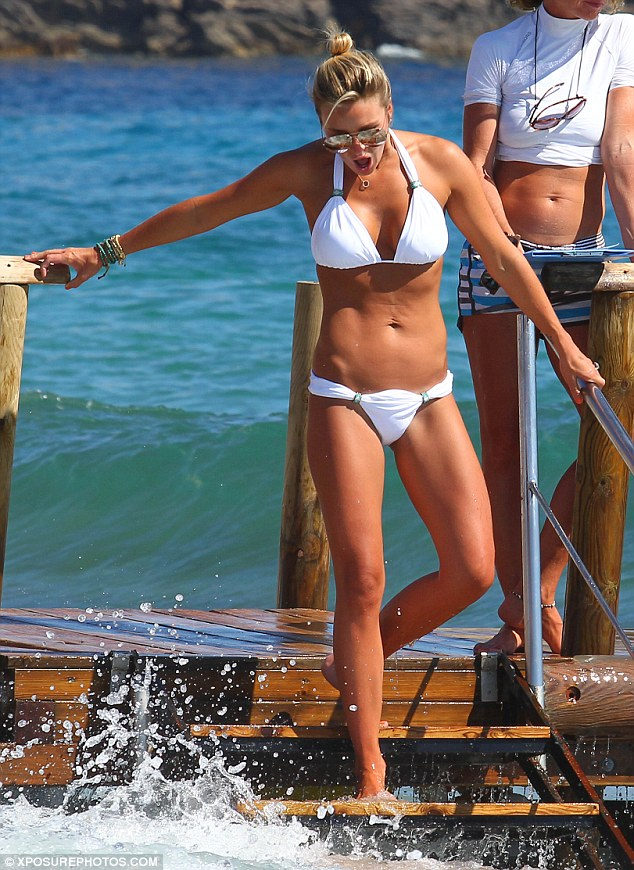 Bit chilly? The model gasps as she dips her toe into the water