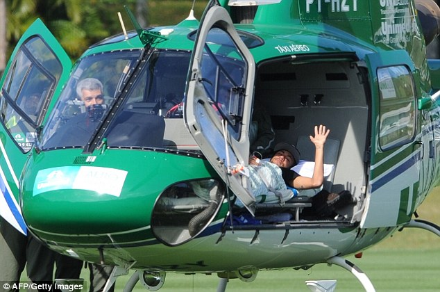 Thanks: Neymar managed a wave as he left for Sao Paulo