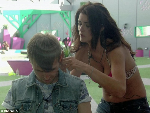 Cutting edge: Helen played amateur hairdresser as she gave Christopher a haircut