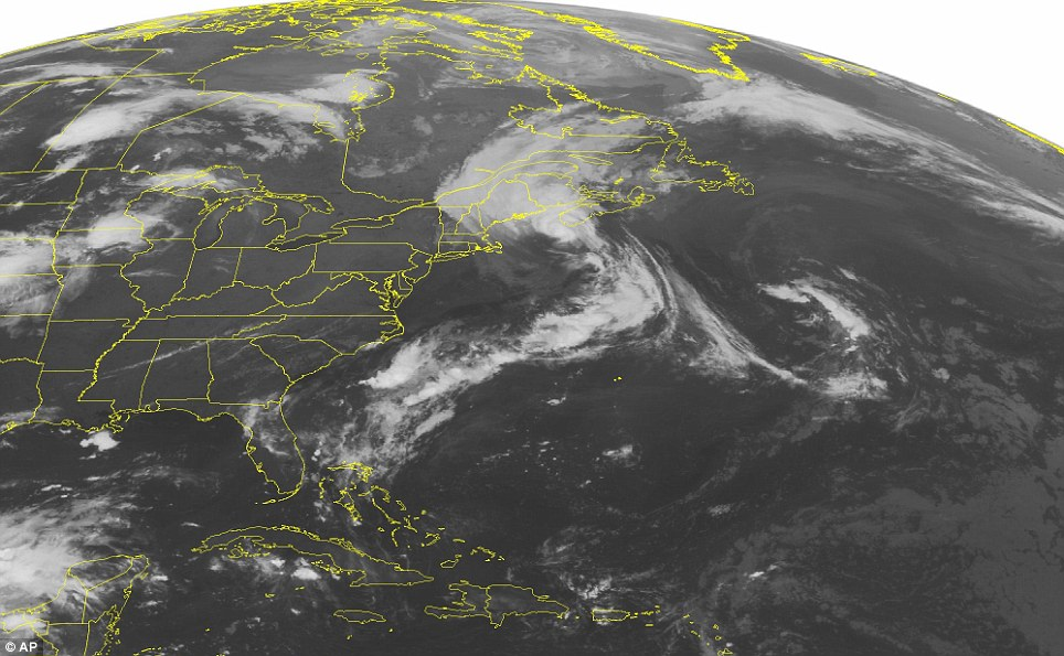 From above: This NOAA satellite image taken Saturday, July 05, 2014 at 01:45 a.m. EDT, shows Hurricane Arthur along the coast of Maine bringing rain to most of northern New England