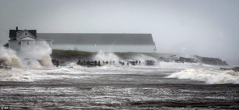 Stormy: Waves crash against rock embankments that protect the Escuminac road against erosion in Escuminac on Saturday