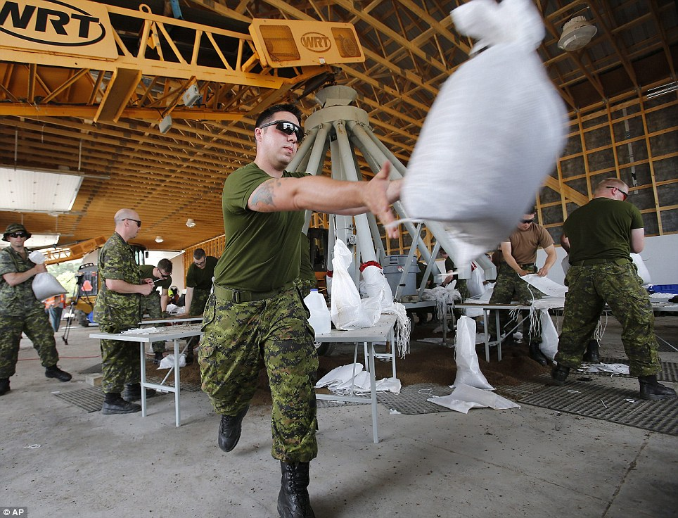 Toss: Military members are seen in Manitoba. Tropical storm Arthur hit Canada's Maritime provinces with near-hurricane strength winds and torrential rains, knocking out power to nearly 200,000 customers