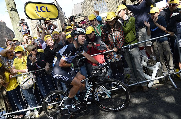 Battling on: Cavendish got back on his bike to finish the first stage but couldn't continue his tour