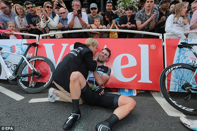 Down and out: Cavendish had to pull out of the Tour de France after injuring his shoulder during stage one