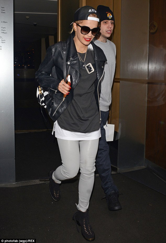 Pins on parade: The Hot Right Now hitmaker kept up the relaxed vibe with a baggy black tee and lace-up boots, but made sure to inject a touch of her signature glamour by showcasing her trim pins in a pair of grey leather trousers
