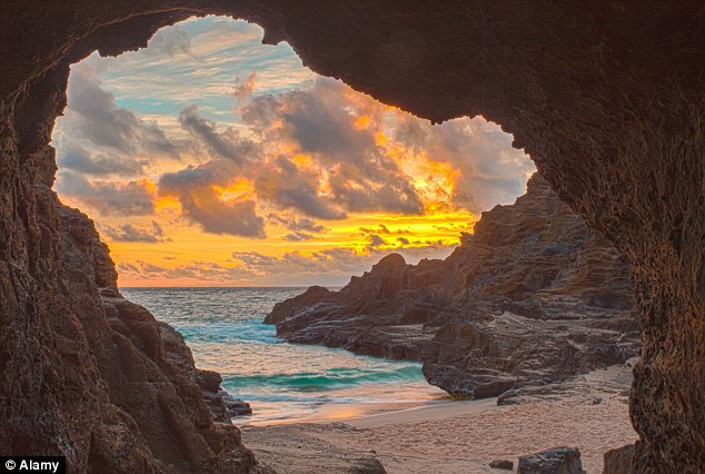 Heavenly beach: Sunrise seen from a lava tube in Halona Cove, the Hawaii beach used in the film From Here to Eternity