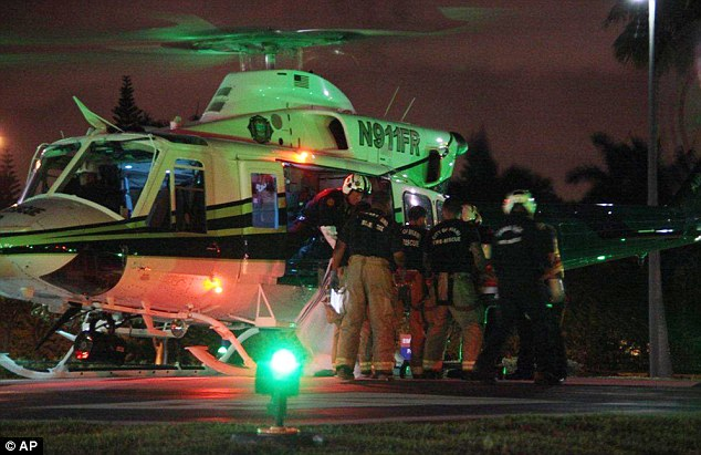 Medivac: Emergency workers bring another injured person to a helicopter for quick transport to a hospital