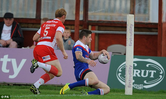 Rare score: St Helen's Mark Percival scores his sides opening try of the game under pressure from Hull KR's David Hodgson