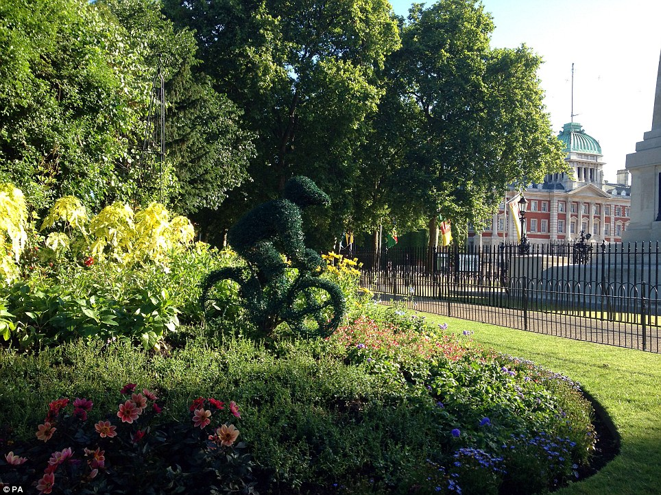 Spot the cyclist: Tour de France-themed topiary in St James's Park, central London, as the world's most famous cycle race moves south for stage three