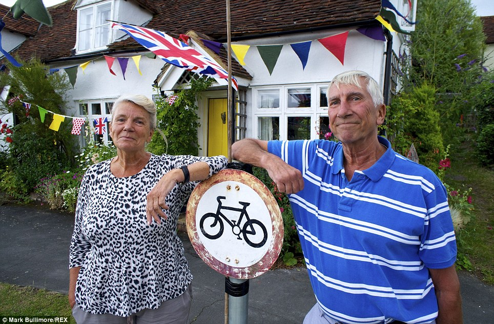 Tribute: Christine and Hugh Ashford-Hodges outside their cottage which they have decorated to welcome the peloton into the village of Finchingfield