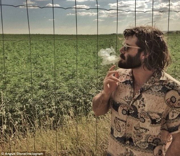 High times: Angus Stone smokes a joint en route to his next gig on the Angus And Julia Stone European tour