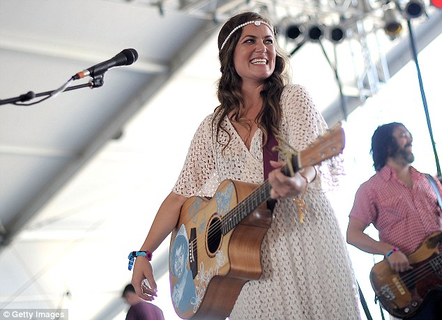 Aussie stars: Julia, 30, on stage with Angus, 28, at the Coachella music festival in LA in April
