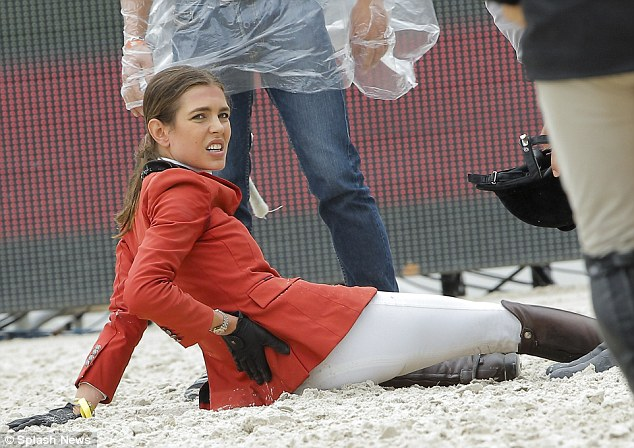 Ouch! Charlotte Casiraghi grimaces after taking a tumble from her horse during the Paris Eiffel Jumping