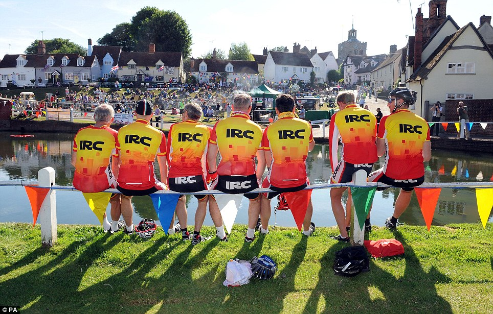Team members: Members of Icknield Road Club from Luton, Bedfordshire, wait in the village of Finchingfield in north Essex for the Tour de France