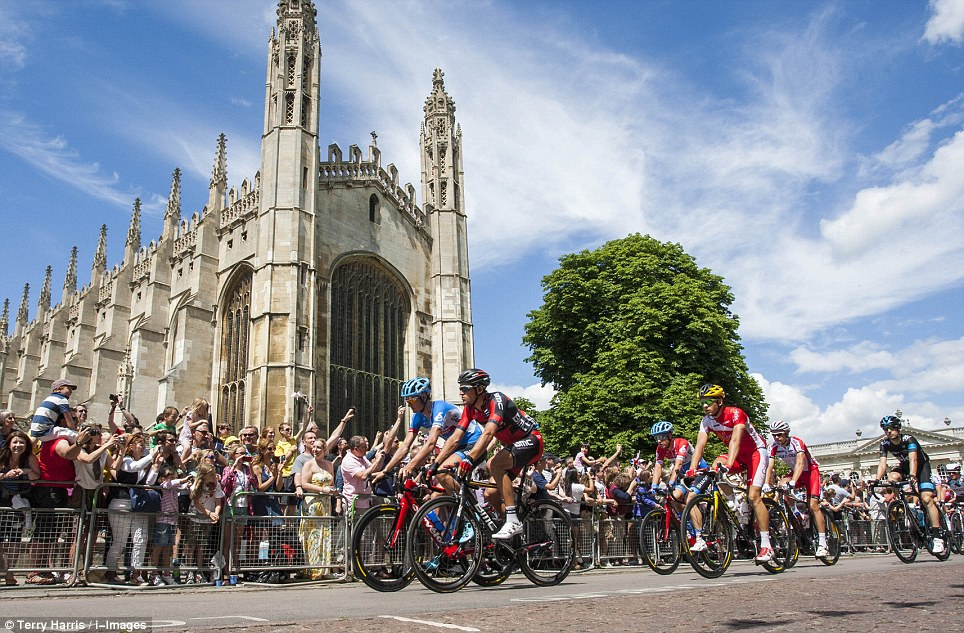 Lycra-clad: Riders pass Kings College, Cambridge this morning after weaving their way through Yorkshire this weekend