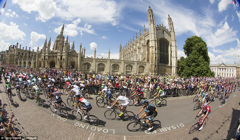Pedal power: Crowds gather in Cambridge to see the cyclists on their way through the historic university city