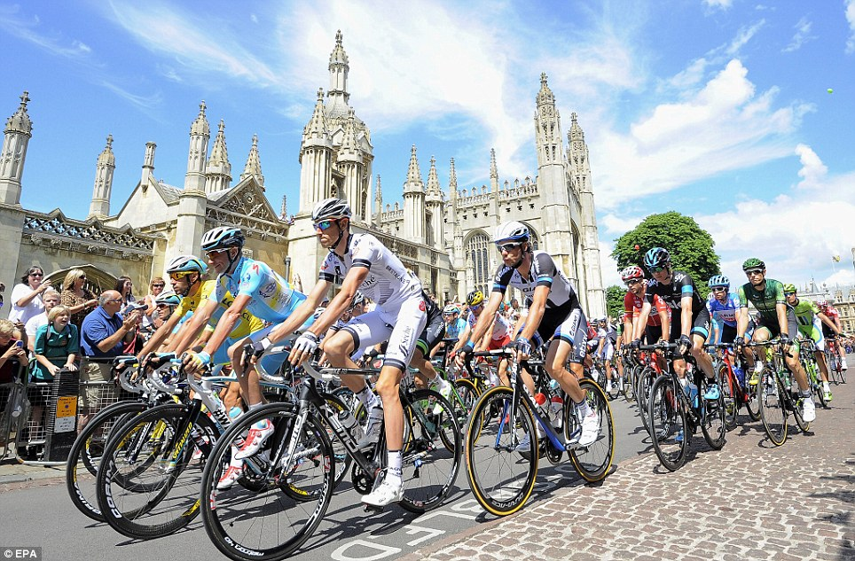 Riding along cobbles: The pack of riders race their way through the street of Cambridge during the third stage of the race