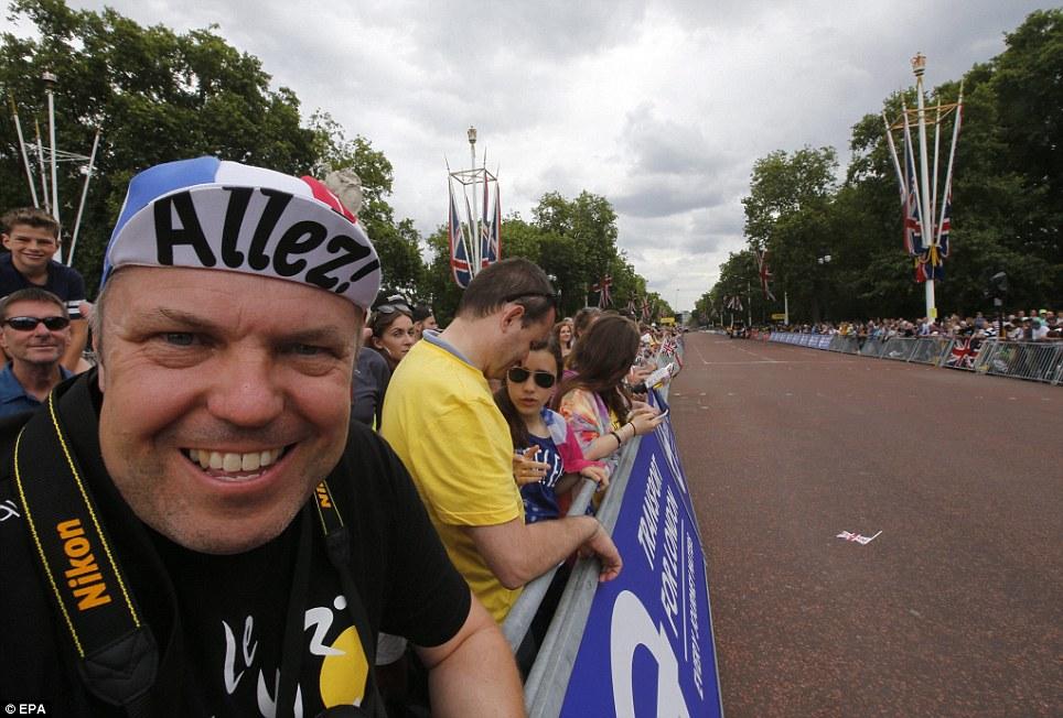 Allez! People line the streets of the Tour de France race route outside Buckingham Palace