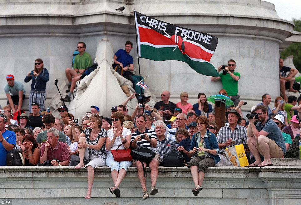 Watching out: Fans gather around Buckingham Palace in preparation for stage three of the Tour de France that will finish in London later today