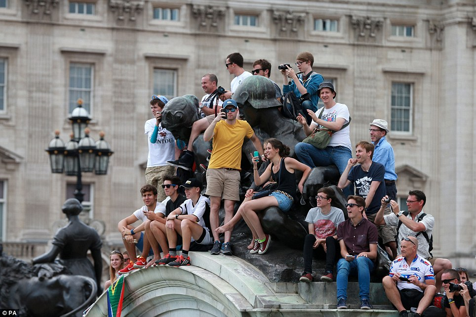 Getting ready: Fans gather around Buckingham Palace ior stage three of the Tour de France which finished in London this afternoon